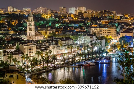 Aerial view on night panorama of old historic town of Split, Croatia. Old architecture and history that attracts many tourists each summer. / Night cityscape town of Split, Croatia. / Long exposure.