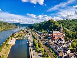 Aerial view on Oberwesel am Rhein. Town on the upper middle Rhine River, Mittelrhein. Beautiful Postcard with blue sky, clouds, church, catle. Rhineland-Palatinate (Rheinland-Pfalz), Germany.  UNESCO
