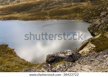 Aerial view on Pedourres lake in Andorra, Pyrenees, Autumn day.
