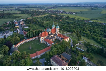 """Aerial view on Pilgrimage Church of the Visitation of the Virgin Mary - pilgrimage site of European significance """"The Holy Hill"""" from-afar visible silhouette of basilica minor over moravian landscape."""