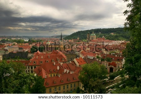 Aerial view on red roofs of old houses in Prague, Czech Republic.