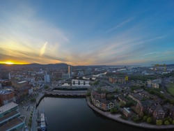 aerial view on river and bridge in belfast northern ireland. beautiful sunset over city view from above