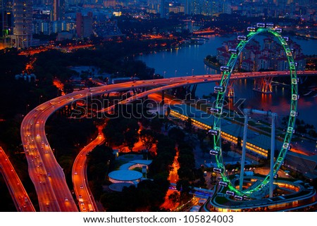 Aerial view on Singapore at night - stock photo