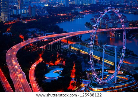 Aerial view on Singapore Flyer from roof Marina Bay Sands at night