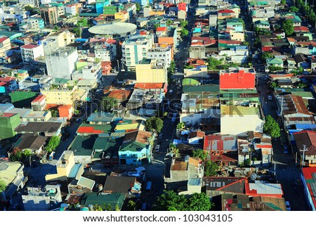 Aerial view on slum in Makati district - modern financial and business district of Metro Manila, Philippines