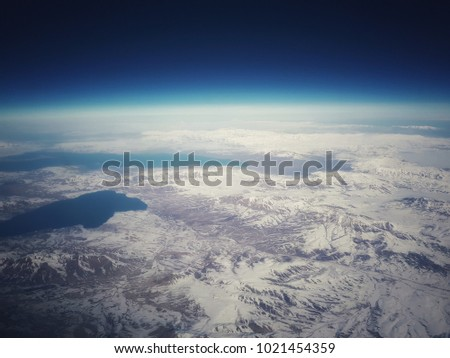 Aerial view on snowy mountains and lake #1021454359