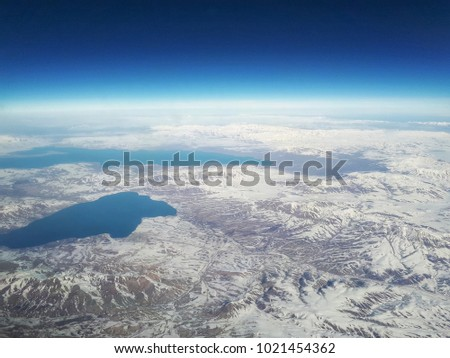 Aerial view on snowy mountains and lake #1021454362