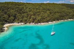 Aerial view on the beautiful bay on Rab island in Croatia. Turquoise color Adriatic sea of Dundo beach in Kampor and yacht in the bay, Rab Island