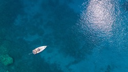 Aerial view on the boat in the blue sea. Vaction concept.