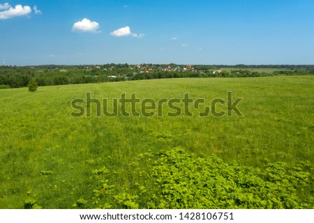 Aerial view on the countryside and the agricultural field #1428106751