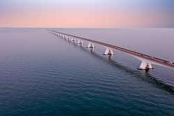 Aerial view on the longest bridge in the Netherlands, Zealand bridge at sunset