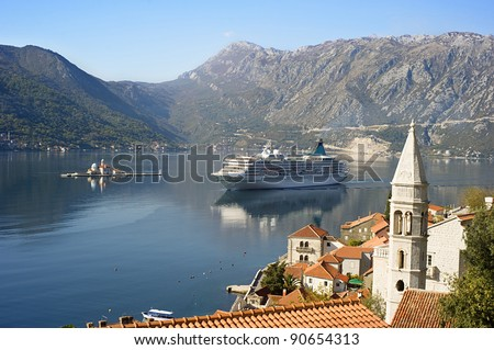 "Aerial view on town Perast with Church ""Our Lady of the rocks"" and cruise liner. Montenegro - stock photo"