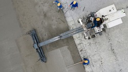 Aerial view or top view construction worker pouring concrete