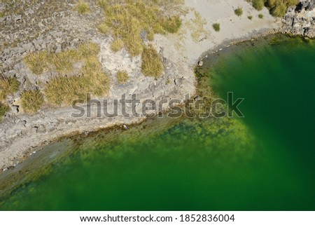 Aerial view over a lake with chemical dark green water  Photo stock ©