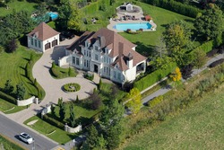 Aerial view over a large upscale luxury house on a sunny summer day. Canada.