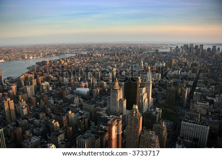 Aerial view over east lower Manhattan from Empire State building top, New York at sunset