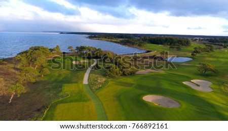 Aerial view over fairway on a golf course #766892161