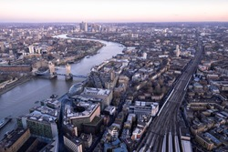 Aerial view over London city with view of Tower Bridge and Canary Wharf at dusk
