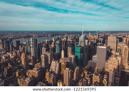 Aerial View over New York City at Sunny Day #1221569395