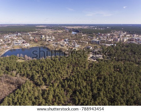 Aerial view over resort city Druskininkai, Lithuania. During early spring daytime. #788943454