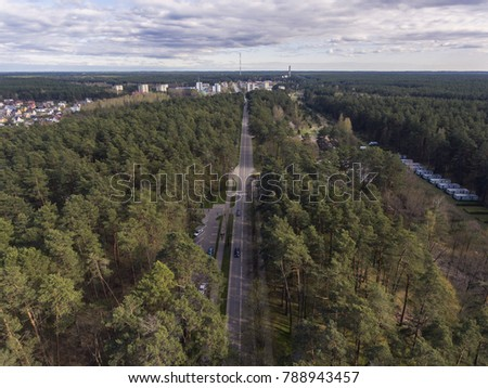 Aerial view over resort city Druskininkai, Lithuania. During early spring daytime. #788943457