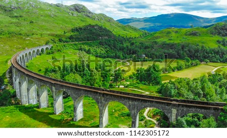 Aerial view over the famous Glenfinnan viaduct in the highlands of Scotland #1142305172