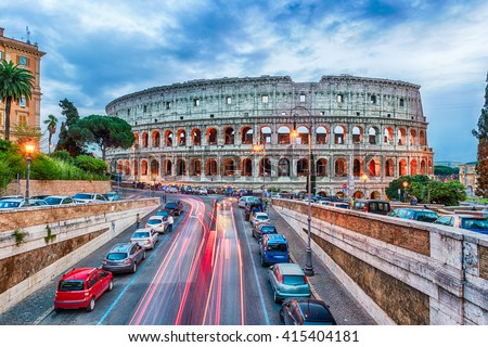 Aerial view over the Flavian Amphitheatre, aka Colosseum in Rome, Italy. Long exposure at dusk #415404181