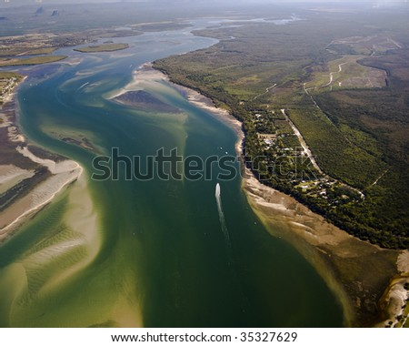 Aerial View over the mouth of a river near Caboolture in Queensland with Glasshouse Mountains in the distance