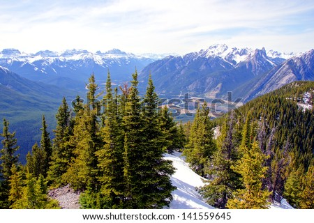 Aerial view over the peaks and forests of the Rocky Mountains at Banff, Canada