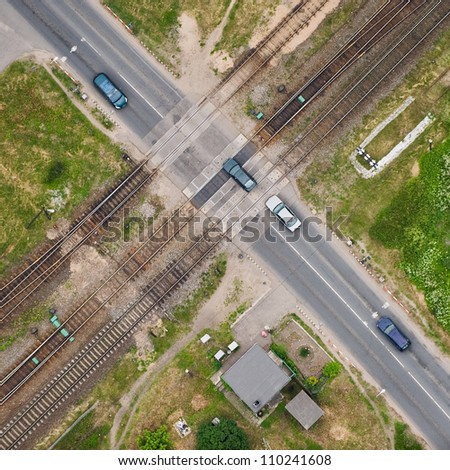 aerial view over the road intersection at the railway