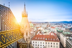 Aerial view over the rooftops of Vienna from the north tower of St. Stephen's Cathedral including the cathedral's famous ornately patterned, multi colored roof created by 230,000 glazed tiles, Austria