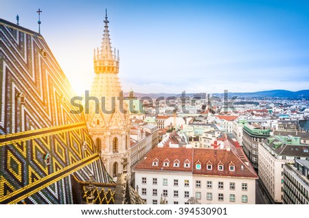 Aerial view over the rooftops of Vienna from the north tower of St. Stephen's Cathedral including the cathedral's famous ornately patterned, multi colored roof created by 230,000 glazed tiles, Austria Stock photo ©