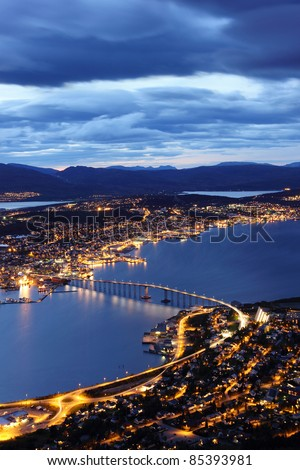 Aerial view over Tromso Bridge - linking the mainland (Tromsdalen) with the city central island (Tromsøya)