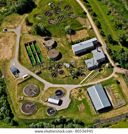 Aerial view over water purification bassins