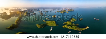 Aerial view panorama of floating fishing village and rock island, Halong Bay, Vietnam, Southeast Asia. UNESCO World Heritage Site. Junk boat cruise to Ha Long Bay. Popular landmark of Vietnam #1217112685