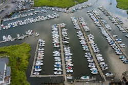 Aerial view panorama of wood platform for boat in the ocean little pier marina