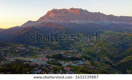 Aerial view Pekan Kundasang and Mount Kinabalu on the ridge. The green and cool atmosphere provide enough relaxation to relax and unwind. Zdjęcia stock ©