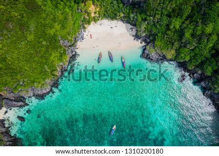 aerial view phi phi island beautiful landscape high season summer holiday  tourists thai and foreign rent a long - tail boat and speed boat snorkel under the sea phi phi island kra bi Thailand