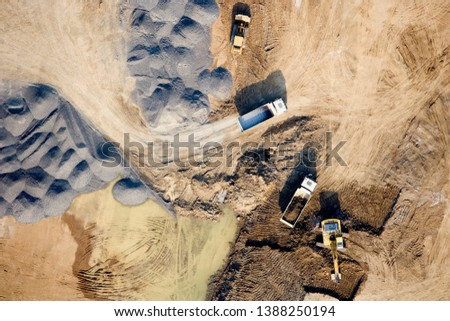 Aerial View Photography (Top View) of Highway Construction Site. Heavy Machinery Working in a Quarry, Mining Quarry, Industrial Place #1388250194