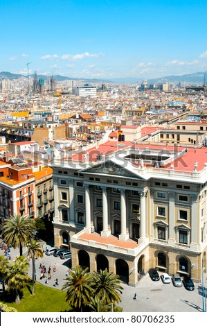 Aerial view Portal de la Pau Square in La Rambla, in Barcelona, and its skyline, Spain - stock photo