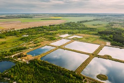 Aerial View Retention Basins, Wet Pond, Wet Detention Basin Or Stormwater Management Pond, Is An Artificial Pond With Vegetation Around The Perimeter, And Includes A Permanent Pool Of Water In Its