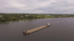 Aerial view:river barge on the beautiful river.Aerial:Cargo ship on the river Volga.