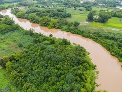 Aerial view river flood forest nature woodland area green tree, Top view river lagoon pond with water flood from above, Bird eye view landscape jungles lake flowing wild water after the rain