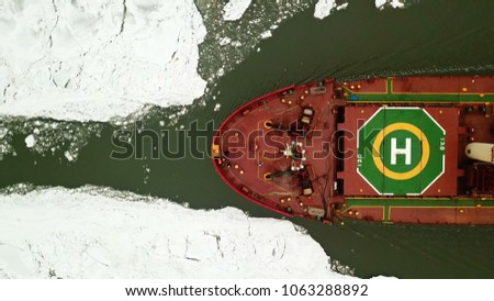 Stock Photo Aerial view. ship moving in frozen sea