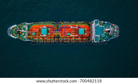 Aerial view shot from drone of crude oil tanker ship in business logistic and transportation the ocean view from above.