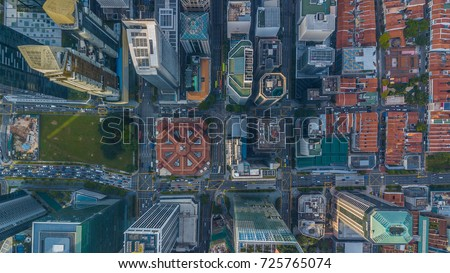 Aerial view shot from drone Singapore City skyline business building and financial district at Singapore City, Singapore. #725765074