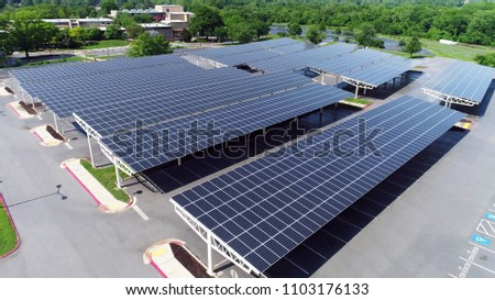 aerial view solar panels in parking.