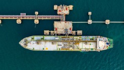 Aerial view tanker park offshore at oil terminal commercial port for transfer crude oil to oil refinery, Global business logistic industrial crude oil and fuel tanker ship.