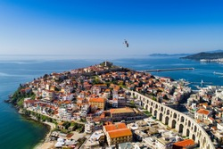 Aerial view the city of Kavala in northern Greek, ancient aqueduct Kamares, homes and medieval city wall