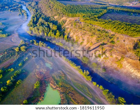 Aerial view to foggy valley with river Siverskyi Donets and Zmiiv hills with withered grass, calm autumn landscape at sunrise. Kharkiv region, Ukraine Zdjęcia stock ©